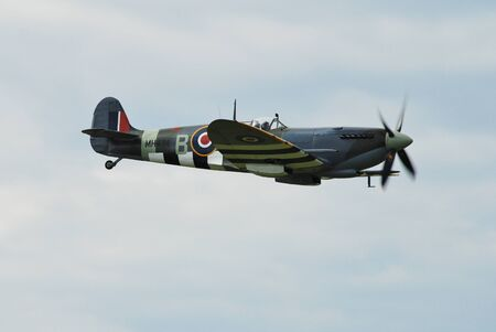 Dunsfold, England - August 23, 2014 - Supermarine Spitfire Mk 1XB, MH434, displays at the Dunsfold airshow. The aircraft was built in 1943 before serving in the Royal Air Force.