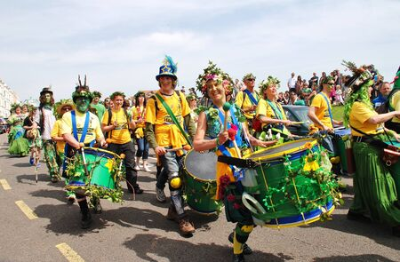 Hastings, England - May 5, 2014 - The Sambalanco community samba band perform during the parade on the West Hill at the annual Jack In The Green festival. The festival marks the May Day public holiday in Britain.