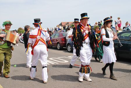 cotswold: Hastings, England - May 5, 2014 - Musicians from Mad Jacks Morris perform at the parade on the West Hill during the annual Jack In The Green festival. Editorial