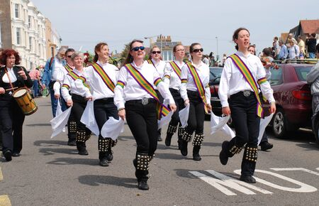 morris: Hastings, England - May 5, 2014 - Morris dancers perform at the parade on the West Hill during the annual Jack In The Green festival.