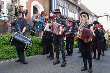Hastings, England - May 5, 2014 - Black faced musicians perform at the parade through the Old Town during the annual Jack In The Green festival.