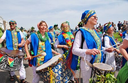 Hastings, England - May 5, 2014 - The Dende Nation samba drum troupe perform at the parade on the West Hill during the annual Jack In The Green festival.