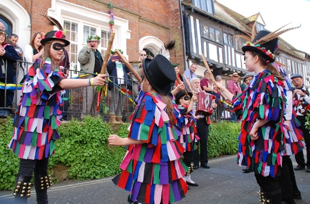Hastings, England - May 5, 2014 - Young Morris dancers perform in the Old Town during the annual Jack In The Green festival.