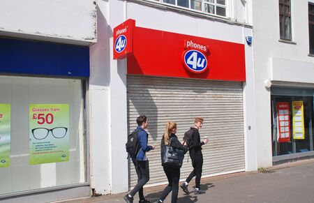 ceased: Hastings, England - April 22, 2015 - Exterior of a Phones 4U mobile phone store. Founded in 1987, all 720 outlets in the UK closed in September 2014 after the company went into administration. Editorial