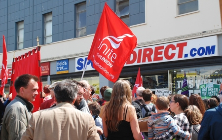 austerity: Hastings, England   - May 30, 2015  - Protestors demonstrate against zero hours contracts at sports shop Sports Direct after a march against austerity and Government cutbacks. Editorial