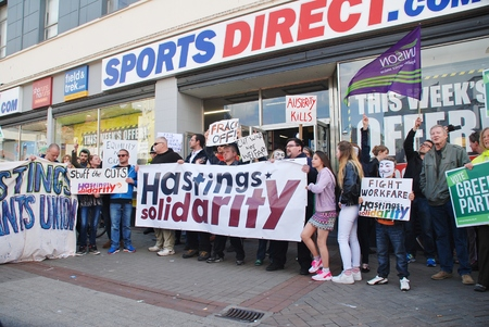 austerity: Hastings, England    - May 30, 2015  - Protestors demonstrate against zero hours contracts at sports shop Sports Direct after a march against austerity and Government cutbacks.