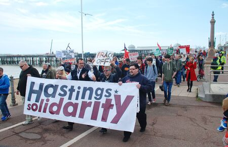 protestors: Hastings, England   - May 30, 2015  -  Protestors take part in a march to demonstrate against austerity and Government cutbacks.