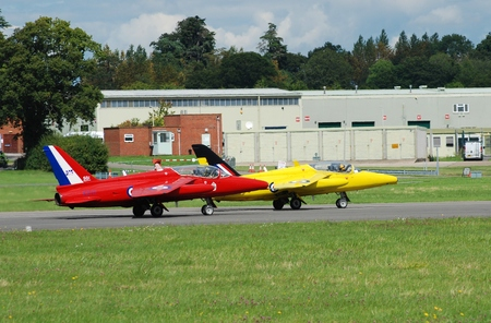 royal air force: Dunsfold, England - August 23, 2014 - Folland Gnat Tmark1, XR992 front, XS111, taxi on the runway during the Dunsfold airshow. The Gnat was used from the 1960s as a fast jet trainer in the Royal Air Force.