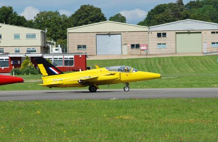 royal air force: Dunsfold, England - August 23, 2014 - Folland Gnat Tmark1, XR992, taxis on the runway during the Dunsfold airshow. The Gnat was used from the 1960s as a fast jet trainer in the Royal Air Force.