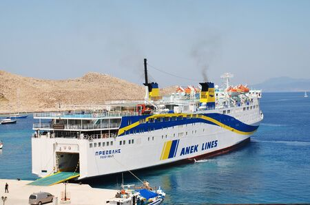 emborio: Halki, Greece - June 16, 2015 - ANEK Lines ferry Prevelis docked at Emborio harbour on the Greek island of Halki. The 142.5mtr ship was built in Japan in 1980 and refitted in 1994.