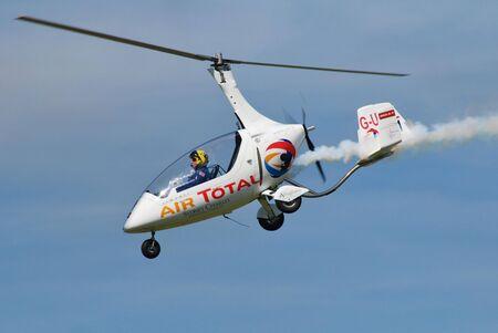 troy: Shoreham-on-Sea, England - August 22, 2015 - Peter Troy-Davies demonstrates his Rotosport UK Calidus Autogyro, G-ULUL, at the Shoreham airshow.
