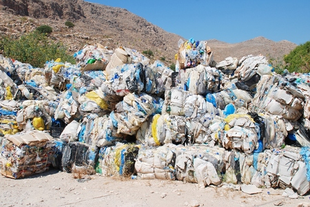 emborio: Halki, Greece - June 12, 2015 - Bales of plastic waste being stored prior to recycling near Emborio on the Greek island of Halki. The recycling scheme was introduced to the island in May 2013. Editorial