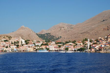 emborio: Halki, Greece - June 17, 2015 - Looking towards the village of Emborio on the Greek island of Halki. The Dodecanese island has a permanent population of only around 300 people.