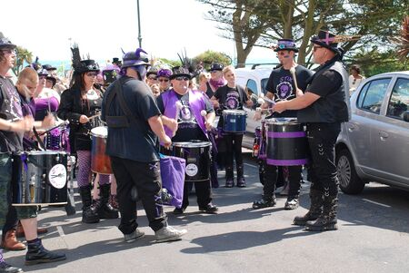 road warrior: St.Leonards-on-Sea, England - July 11, 2015 - The Stix Drummers perform during the parade at the annual St.Leonards Festival in Warrior Square. The free community music and entertainment event was first held in 2006. Editorial