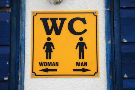 seperation: A public toilet sign showing directions for men and women at Brela in Croatia.