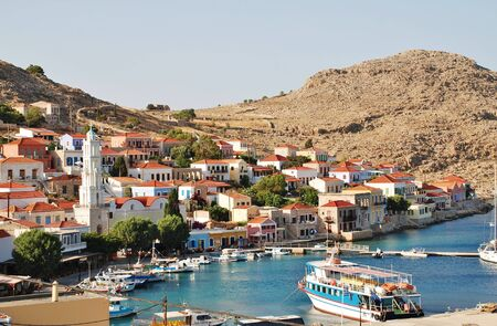 halki: Halki, Greece - June 16, 2015 - Looking down onto the village of Emborio on the Greek island of Halki. The small island near Rhodes has a permanent population of under 300 people.
