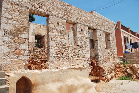 emborio: A derelict old stone building at Emborio on the Greek island of Halki. The village has a number of such buildings. Stock Photo
