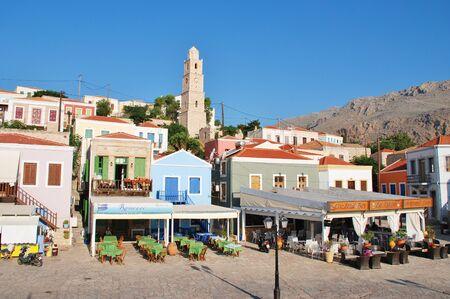 emborio: Halki, Greece - June 17, 2015 - Seafront tavernas at Emborio on the Greek island of Halki. The Dodecanese island has a population of under 300 people. Editorial