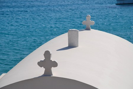 emborio: Crosses on the roof of a small chapel by Pondamos beach at Emborio on the Greek island of Halki. Stock Photo