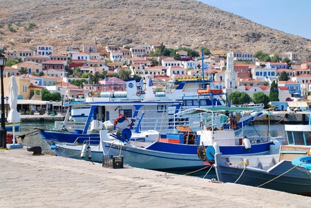 emborio: Halki, Greece - June 5, 2015 - Small boats moored in the harbour at Emborio on the Greek island of Halki. The Dodecanese island has a population of under 300 people.