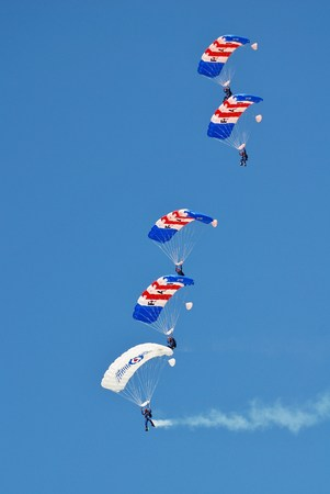 royal air force: Shoreham, England - August 22, 2015 - Royal Air Force parachute display team The Falcons perform at the Shoreham airshow. The team were first formed in 1965.