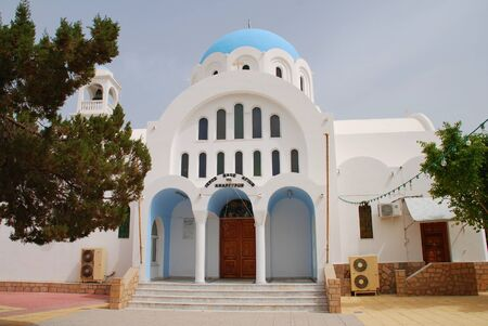 Agistri, Greece - May 12, 2016 - The domed church of Agioi Anargyroi at Skala on the Greek island of Agistri. The small island is under an hour from Piraeus harbour in Athens. Editorial