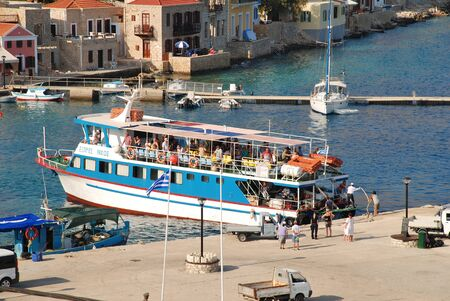 emborio: Halki, Greece - July 20, 2016 - Ferry boat Nikos Express docks at Emborio harbour on the Greek island of Halki. The ferry is one of several that operate between Halki and Kamiros Skala in Rhodes.