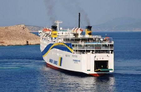 reversing: Halki, Greece - July 19, 2016 - Anek Lines ferry Prevelis docks at Emborio harbour on the Greek island of Halki. The 142.5mtr vessel was built in Japan in 1980. Editorial