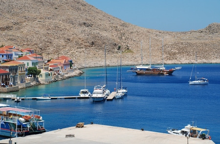 emborio: Halki, Greece - June 15, 2015 - Boats moored in Emborio harbour on the Greek island of Halki. The harbour forms the hub of the islands main industries of tourism and fishing. Editorial