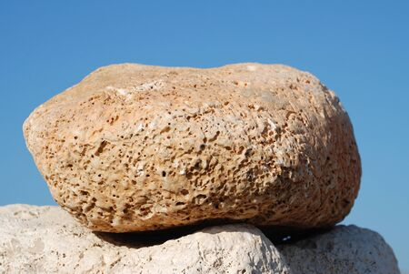 emborio: A large stone on the summit of a stone tower on Ftenagia beach at Emborio on the Greek island of Halki. Stock Photo
