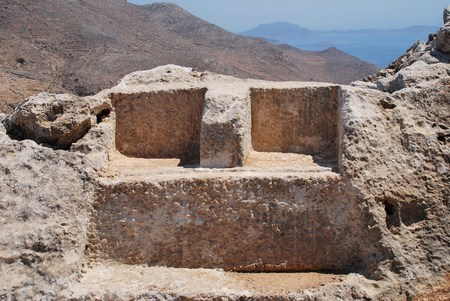 inscribed: The thrones of Greek gods Zeus and Hekate carved in stone in the hills above Chorio on the Greek island of Halki. The inscribed stones date from the Hellenistic period of Ancient Greece (323-31 BC).