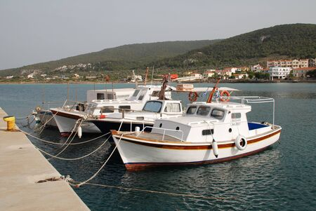 athenians: Agistri, Greece - May 12, 2016 - Small boats moored in Milos harbour on the Greek island of Agistri. Just under an hour from Piraeus, the island is a popular destination for Athenians. Editorial