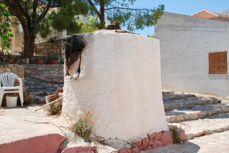 emborio: A traditional old stone bread oven in the streets of Emborio on the Greek island of Halki. Stock Photo