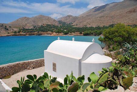 emborio: A small chapel above Pondamos beach at Emborio on the Greek island of Halki.
