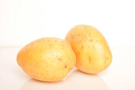 Fresh potatoes on white background
