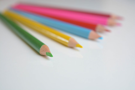 educating: Colorful pencils on white background Stock Photo