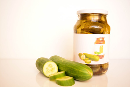 airtight: Fresh and canned cucumbers Stock Photo