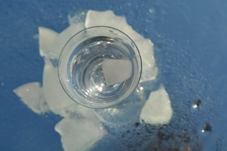 crystal background: Ice cubes and a cup
