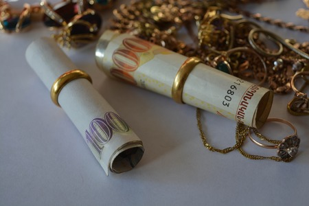 Group of beautiful  jewelry and money, gold