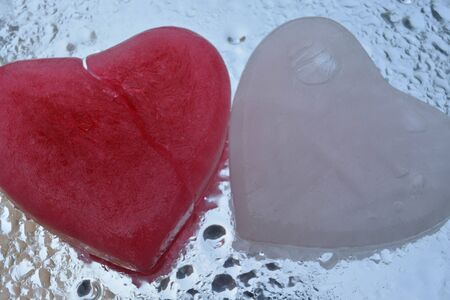 val: Ice heart on water background