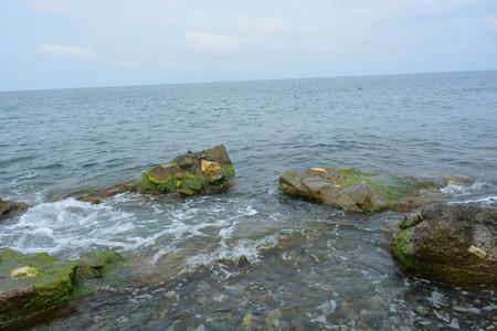 afterglow: Black sea, stones