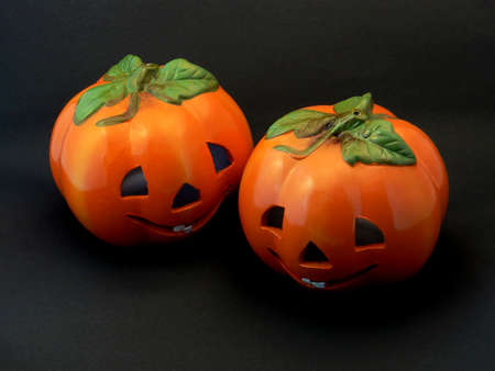 Two Halloween pumpkin-styled lanterns on a dark background.