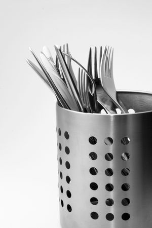 Silver cutlery in a luxury perforated stand. Detail. Stock Photo