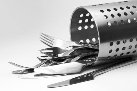 Modern cutlery and a stand. Horizontal perspective.