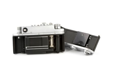 View inside at the open body of a vintage camera isolated on pure white Stock Photo - 10850166