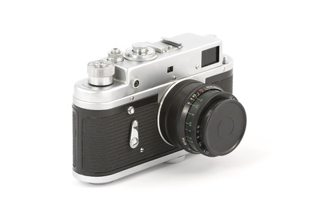 Vintage camera over pure white background