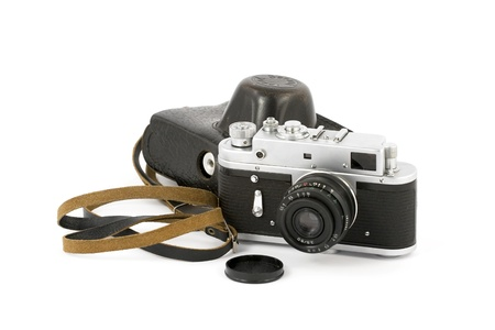 Vintage analog camera with a leather carry-case over pure white background