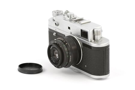 Vintage camera with lens cap isolated on pure white Stock Photo