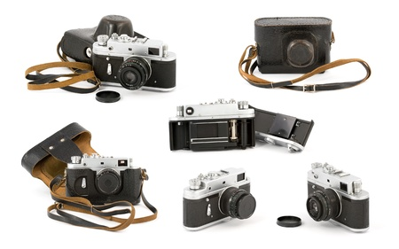 Various shots of a vintage analog film camera. Isolated on pure white background. Stock Photo - 10897246
