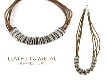 Metal pieces and raw leather stripes forming a beautiful necklace. Isolated over pure white. Copy-space. Stock Photo